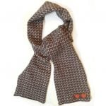 100 % Lambswool Handmade Scarf With A Light Chocolate Brown Wave Pattern.
