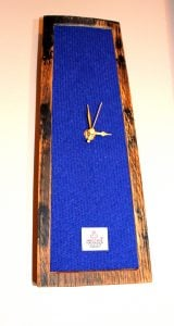 http://www.onemoregift.co.uk/product/harris-tweed-whisky-cask-clock-royal-blue/