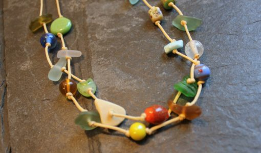 https://www.onemoregift.co.uk/product/scottish-seaglass-mixed-boho- beads-knotted-waxed-cord-necklace/