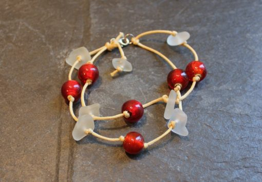 https://www.onemoregift.co.uk/product/scottish-seaglass-white- red -foiled- beads-knotted-waxed-cord-bracelet/