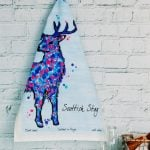 http://www.onemoregift.co.uk/product/Scottish-Monarch of the Glen-Stag- Tea Towel